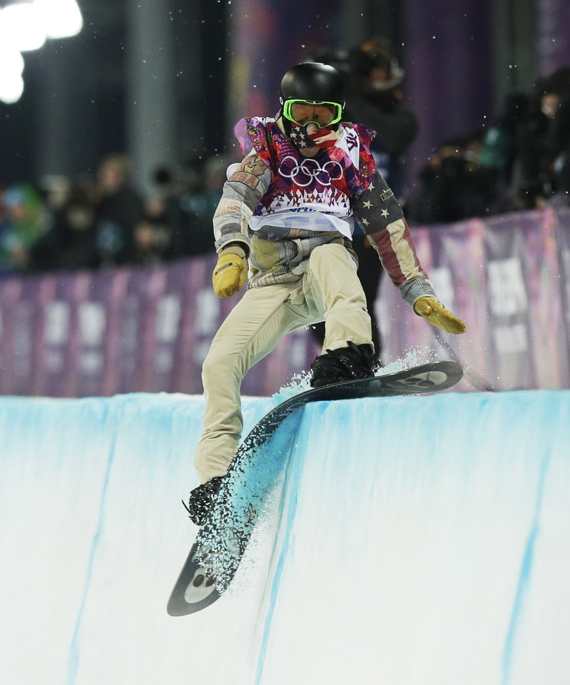 Photo - Shaun White of the United States hits the edge of the half pipe during the men's snowboard halfpipe final at the Rosa Khutor Extreme Park, at the 2014 Winter Olympics, Tuesday, Feb. 11, 2014, in Krasnaya Polyana, Russia. (AP Photo/Andy Wong)