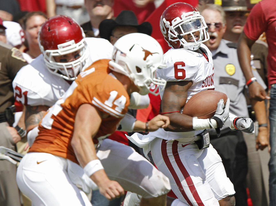 Oklahoma\'s Demontre Hurst (6) returns an interception for a touchdown past Texas\' David Ash (14) during the Red River Rivalry college football game between the University of Oklahoma Sooners (OU) and the University of Texas Longhorns (UT) at the Cotton Bowl in Dallas, Saturday, Oct. 8, 2011. Photo by Chris Landsberger, The Oklahoman