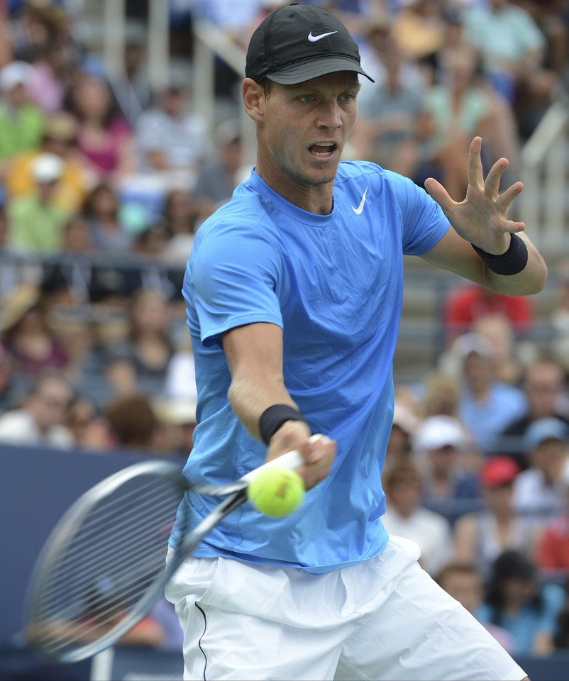 Photo -   Czech Republic's Tomas Berdych returns a shot to Spain's Nicolas Almagro in the fourth round of play at the 2012 US Open tennis tournament, Monday, Sept. 3, 2012, in New York. Berdych won the match. (AP Photo/Henny Ray Abrams)