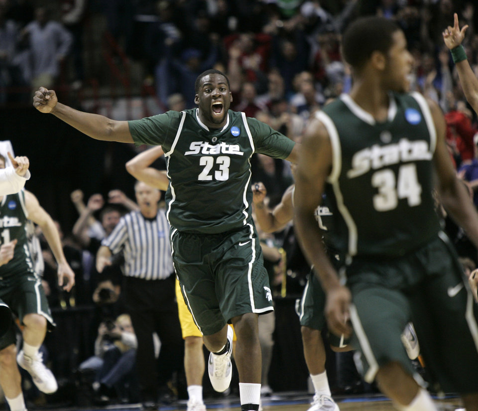 Michigan State's Draymond Green (23) celebrates as he rushes to Michigan State's Korie Lucious, right, after Lucious hit the winning basket after a pass from Green in the second half of an NCAA second-round college basketball game in Spokane, Wash., Sunday, March 21, 2010. Michigan State beat Maryland 85-83. (AP Photo/Don Ryan) ORG XMIT: SPO112