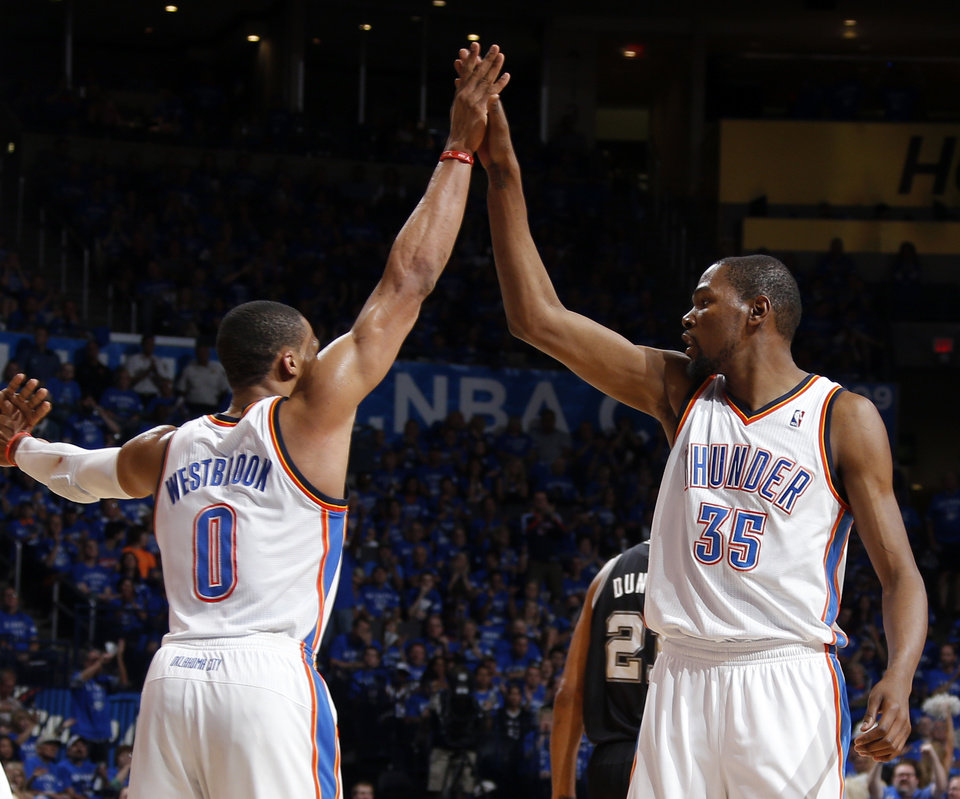 Oklahoma City\'s Russell Westbrook (0) and Kevin Durant (35) celebrate during Game 3 of the Western Conference Finals in the NBA playoffs between the Oklahoma City Thunder and the San Antonio Spurs at Chesapeake Energy Arena in Oklahoma City, Sunday, May 25, 2014. Photo by Bryan Terry, The Oklahoman