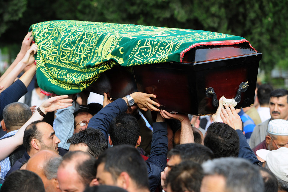 Photo - People carry the coffin of a mine accident victim for burial in Soma, Turkey, Wednesday, May 14, 2014.   Nearly 450 miners were rescued, the mining company said, but the fate of an unknown number of others remained unclear as bodies are still being brought to the surface and burials are underway after one of the world's deadliest mining disasters.(AP Photo/Emre Tazegul)