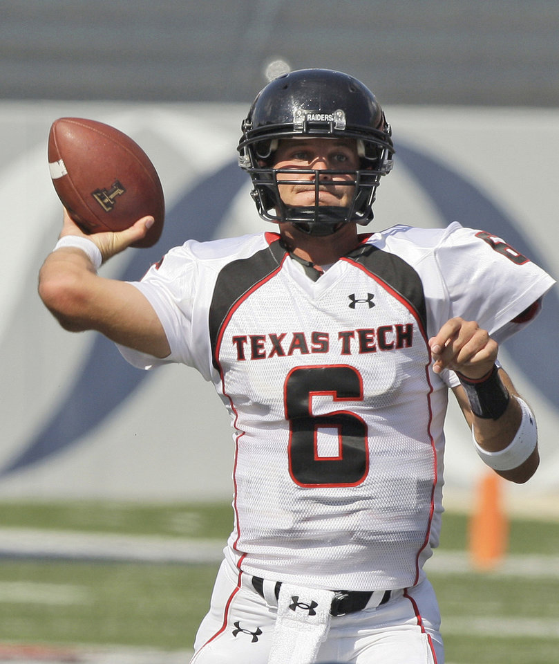 Photo - Texas Tech quarterback Graham Harrell has guided the unbeaten and No. 2 Red Raiders to their highest ranking ever. AP photo