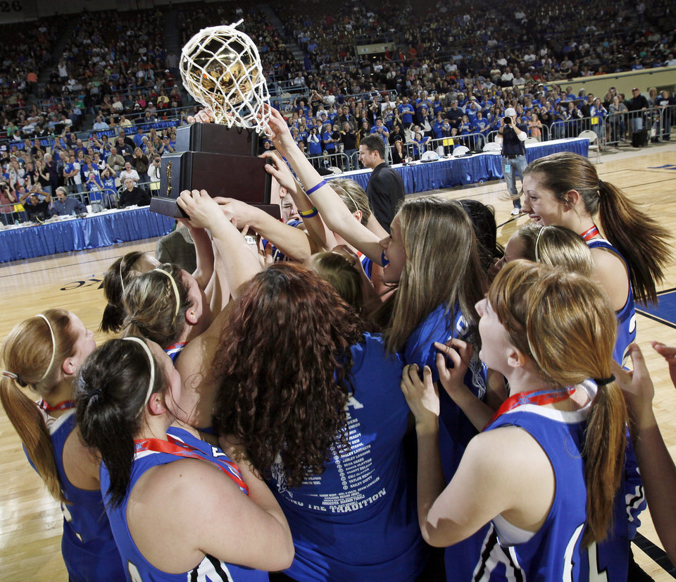 Photo - The Lomega Raiderettes celebrate with the gold ball championship trophy after the Class B girls state championship high school basketball game between Hammon and Lomega at State Fair Arena in Oklahoma City, Saturday, March 3, 2012. Lomega won, 49-44. Photo by Nate Billings, The Oklahoman