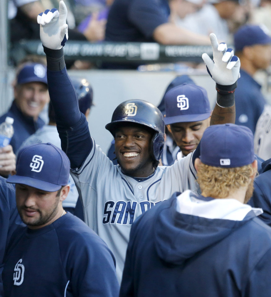 Photo - San Diego Padres' Cameron Maybin celebrates in the dugout after his home run off Chicago White Sox starting pitcher John Danks during the third inning of an interleague baseball game Friday, May 30, 2014, in Chicago. (AP Photo/Charles Rex Arbogast)