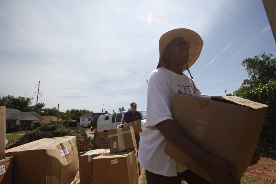 Photo - Dorothy Maxie of Wheeler Avenue Baptist Church in Houston, Texas, carries a box of donations into Christ United Methodist Church, 1006 NE 17 in Oklahoma City.   Aliki Dyer - The Oklahoman