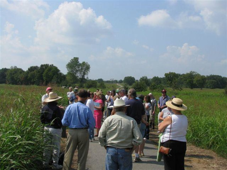 Photo - People take tours of the archaeological grounds at Spiro Mounds. PHOTO PROVIDED.