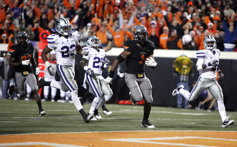 Photo - Oklahoma State's Joseph Randle (1) scores the game-winning touchdown in front of Kansas State's Emmanuel Lamur (23), David Garrett (27) and Allen Chapman (3) during a college football game between the Oklahoma State University Cowboys (OSU) and the Kansas State University Wildcats (KSU) at Boone Pickens Stadium in Stillwater, Okla., Saturday, Nov. 5, 2011.  Photo by Sarah Phipps, The Oklahoman
