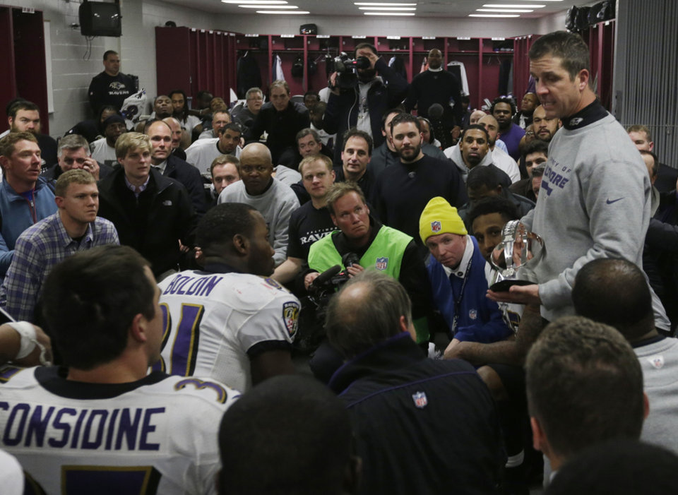 Baltimore Ravens head coach John Harbaugh talks to his team following the NFL football AFC Championship football game against the New England Patriots in Foxborough, Mass., Sunday, Jan. 20, 2013. The Ravens defeated the Patriots, 28-13, to advance to Super Bowl XLVII. (AP Photo/Elise Amendola)