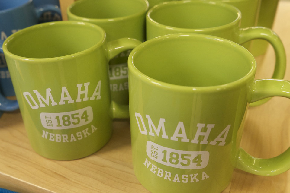 Photo - In this photo taken on Monday, Jan. 20, 2014,  coffee mugs emblazoned with the word Omaha sit on a display shelf in an concourse shop in the Omaha Airport in Omaha, Neb.