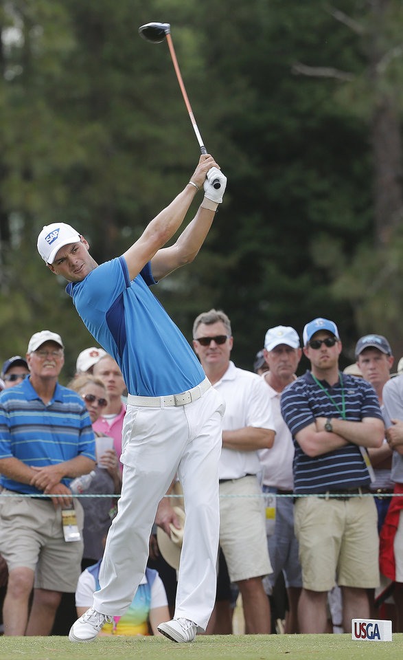 Photo - Martin Kaymer, of Germany, watches his tee shot on the eighth hole during the first round of the U.S. Open golf tournament in Pinehurst, N.C., Thursday, June 12, 2014. (AP Photo/Matt York)