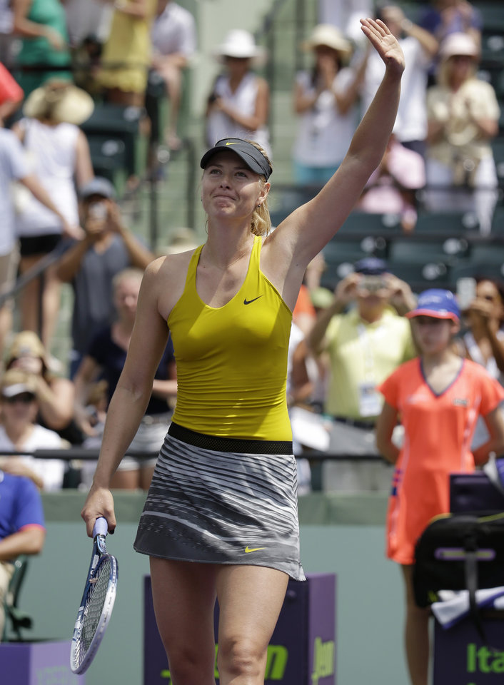 Photo - Maria Sharapova, of Russia, waves after defeating Kirsten Flipkens, of Belgium, 3-6, 6-4, 6-1, at the Sony Open tennis tournament, Monday, March 24, 2014, in Key Biscayne, Fla. (AP Photo/Lynne Sladky)