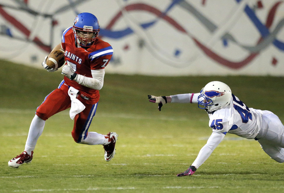 Photo - OCS' Blake Barnes gets by Millwood's Chris Thompson during the high school football game between Oklahoma Christian and Millwood at Oklahoma Christian Schools in Edmond, Okla.,  Friday, Oct. 5, 2012. Photo by Sarah Phipps, The Oklahoman
