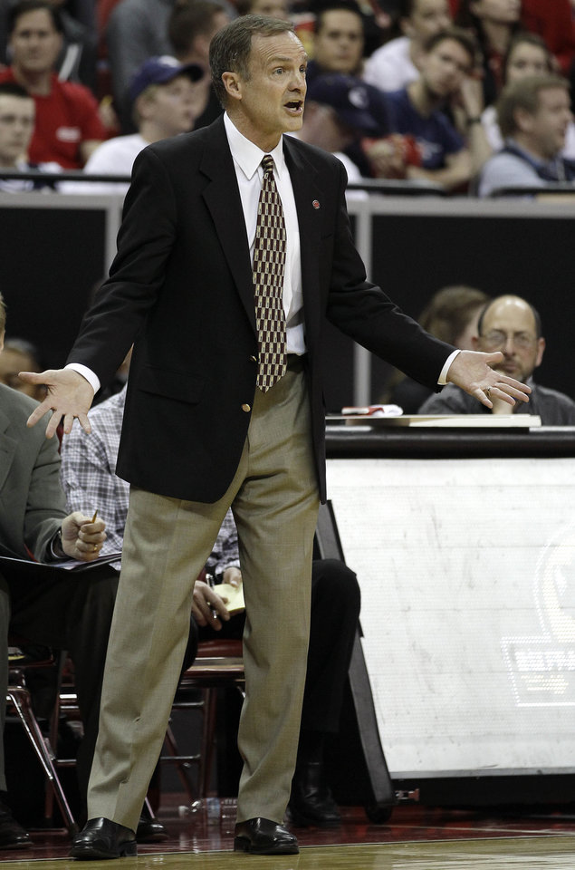 UNLV coach Lon Kruger talks to players during the first half of an NCAA college basketball game against Air Force in the second round of the Mountain West Conference tournament, Friday, March 11, 2011, in Las Vegas. (AP Photo/Julie Jacobson)