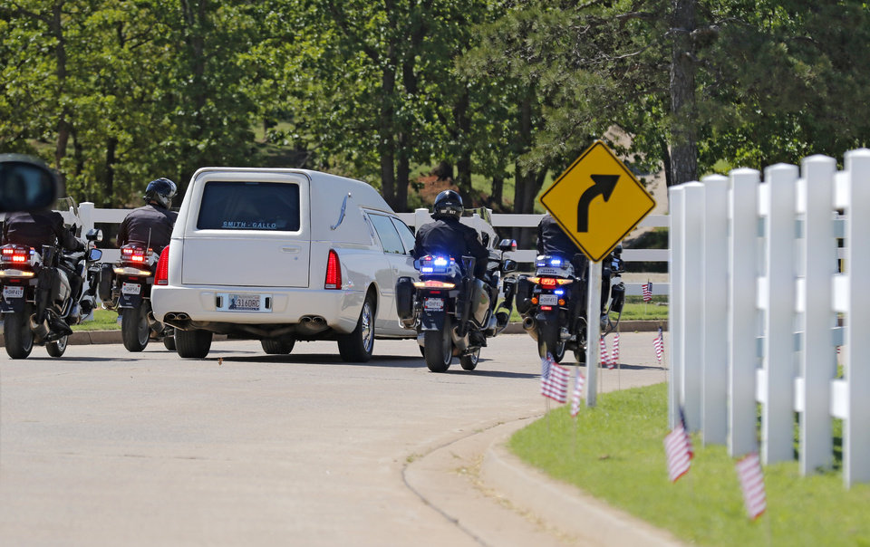 Photo - Motorcycle officers escort the hearse carrying the body of fallen Logan County Deputy David Wade to his funeral service in Guthrie, Monday April 24, 2017. Photo By Steve Gooch, The Oklahoman