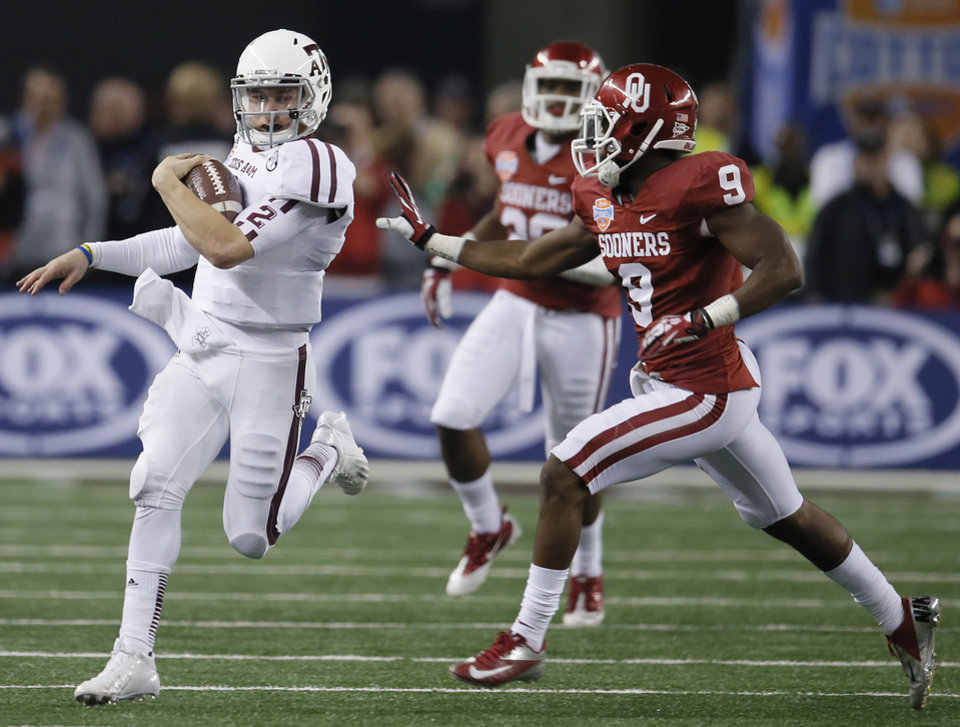 Texas A&M's Johnny Manziel (2) runs past Oklahoma's Gabe Lynn (9) during the college football Cotton Bowl game between the University of Oklahoma Sooners (OU) and Texas A&M University Aggies (TXAM) at Cowboys Stadium on Friday Jan. 4, 2013, in Arlington, Tx. Photo by Chris Landsberger, The Oklahoman
