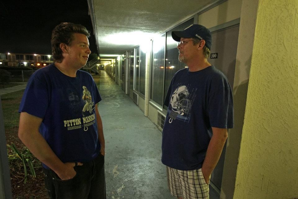 ADVANCE FOR USE WEDNESDAY, FEB. 29, 2012 at 12:01 A.M. EDT AND THEREAFTER - In this Thursday, Feb. 9, 2012 photo, Zach Montgomery, left, and his father, Ronald, talk outside their family's motel room in Clermont, Fla. Here in Lake County the number of homeless students has skyrocketed, from 122 in 2005 to more than 2,600 this school year. It's the largest increase in hard hit Florida and echoes the rising numbers seen nationwide as well. (AP Photo/John Raoux)