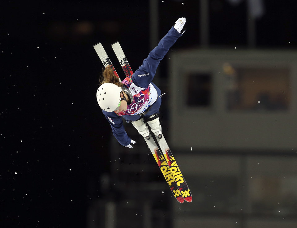 Photo - Ashley Caldwell of the United States jumps during the women's freestyle skiing aerials final at the Rosa Khutor Extreme Park, at the 2014 Winter Olympics, Friday, Feb. 14, 2014, in Krasnaya Polyana, Russia. (AP Photo/Sergei Grits)