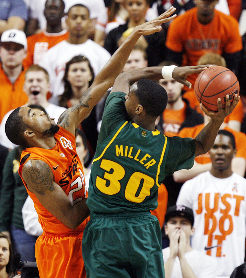 OSU\'s Michael Cobbins (20) defends Baylor\'s Quincy Miller (30) in the first half of a men\'s college basketball game between the Oklahoma State University Cowboys and the Baylor University Bears at Gallagher-Iba Arena in Stillwater, Okla., Saturday, Feb. 4, 2012. Photo by Nate Billings, The Oklahoman
