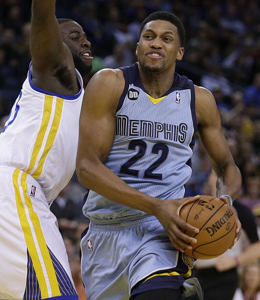 Photo - Memphis Grizzlies' Rudy Gay (22) drives the ball past Golden State Warriors' Draymond Green during the first half of an NBA basketball game Wednesday, Jan. 9, 2013, in Oakland, Calif. (AP Photo/Ben Margot)