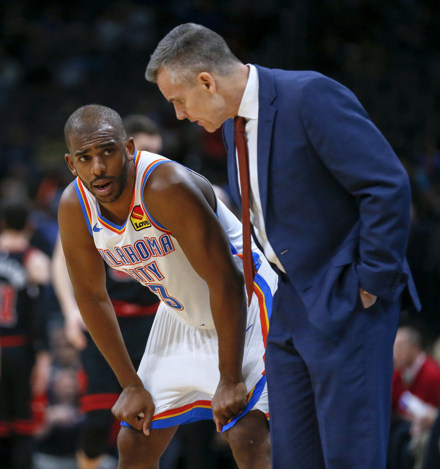 Photo - Oklahoma City's Chris Paul (3) talks to coach Billy Donovan during an NBA basketball game between the Oklahoma City Thunder and Chicago Bulls at Chesapeake Energy Arena in Oklahoma City, Monday, Dec. 16, 2019. [Nate Billings/The Oklahoman]