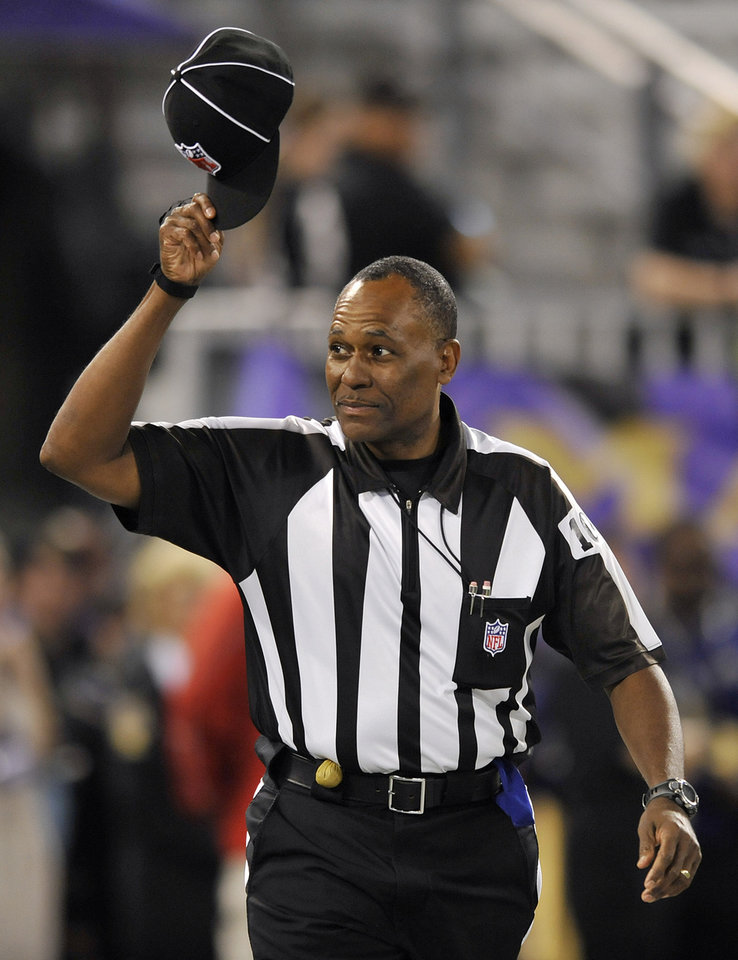 Photo -   Head linesman Wayne Mackie tips his cap as he walks on the field before an NFL football game between the Baltimore Ravens and Cleveland Browns in Baltimore, Thursday, Sept. 27, 2012. (AP Photo/Gail Burton)