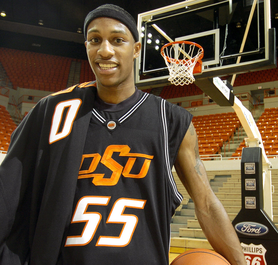 Photo - OKLAHOMA STATE UNIVERSITY: OSU college basketball player Torre Johnson at Gallagher-Iba Arena in Stillwater, Okla., Friday, January, 6, 2006. Johnson is wearing his normal number, 55, and has the jersey he wore when the Cowboys played Pepperdine, number 0, over his shoulder.  By Matt Strasen /The Oklahoman