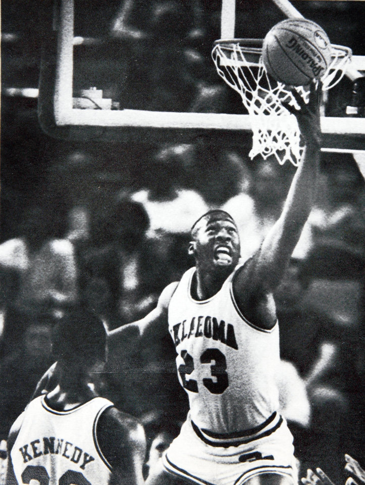 Photo - Former OU basketball player Wayman Tisdale. Wayman Tisdale puts in a reverse layup for the Sooners. Photo taken , Photo published 3/15/1985 in The Daily Oklahoman  Staff Photo by Doug Hoke ORG XMIT: KOD