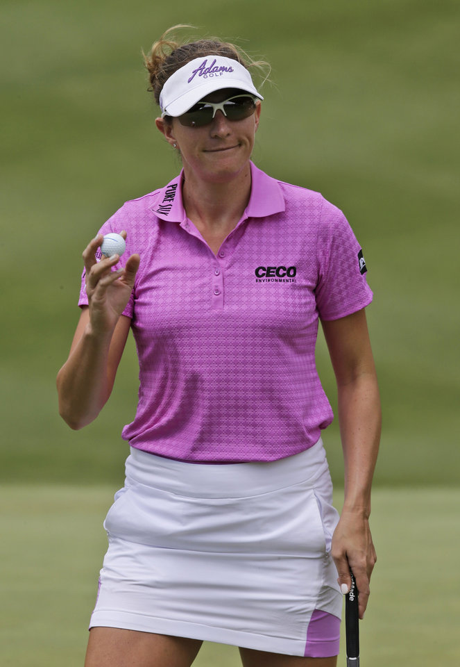 Photo - Brittany Lang tips her ball to the crowd after a par saving putt on the ninth hole during the second round of the LPGA Kingsmill Championship golf tournament at the Kingsmill resort in Williamsburg, Va., Friday, May 16, 2014. (AP Photo/Steve Helber)