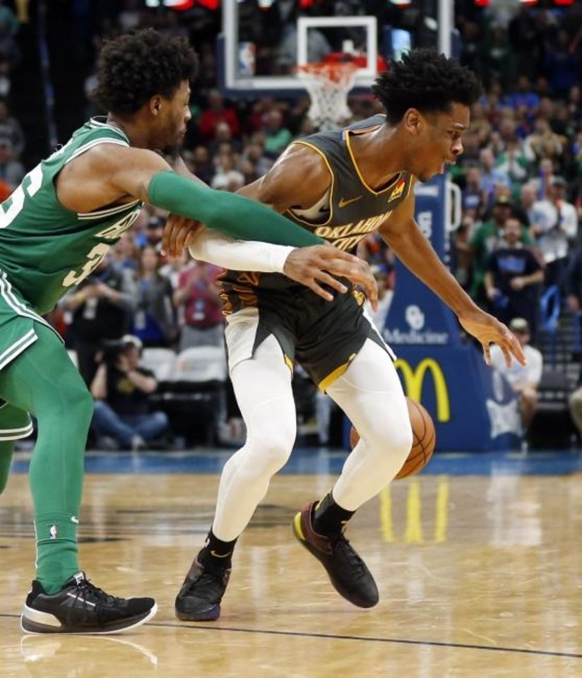 Photo -  Boston's Marcus Smart, left, steals the ball from Oklahoma City's Shai Gilgeous-Alexander late in the fourth quarter of Sunday's game at Chesapeake Energy Arena. The steal helped Boston come away with a 112-111 win. [Nate Billings/The Oklahoman]