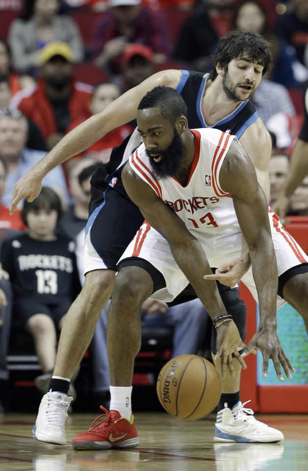 Photo - Minnesota Timberwolves' Ricky Rubio, rear, of Spain, tries to knock the ball away from Houston Rockets' James Harden (13) in the first half of an NBA basketball game Friday, March 15, 2013, in Houston. (AP Photo/Pat Sullivan)