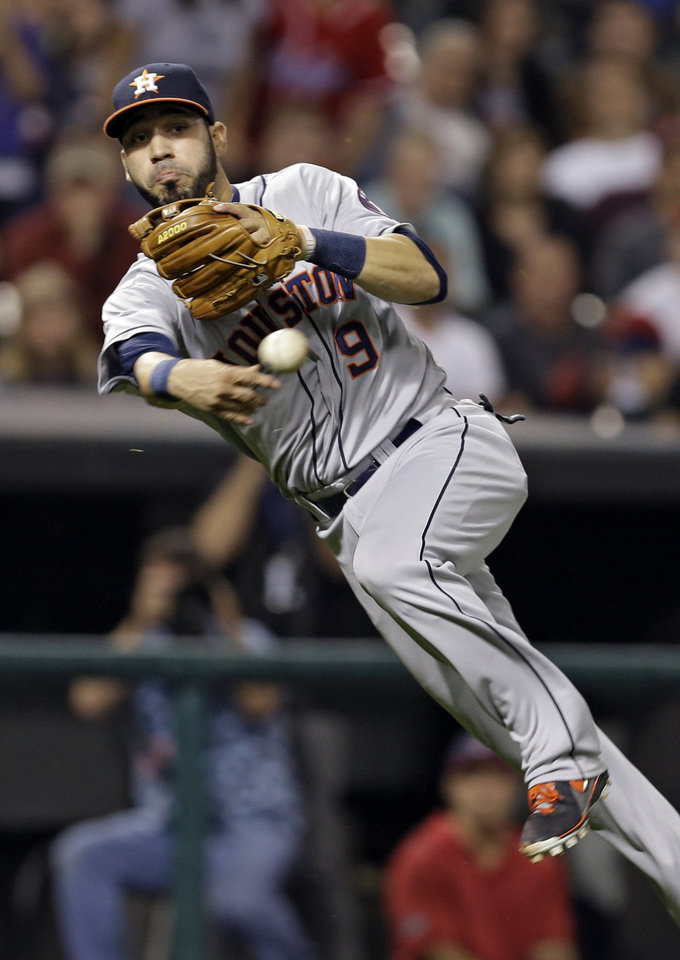 Houston Astros third baseman Marwin Gonzalez throws to first too late to get Cleveland Indians' Asdrubal Cabrera on a ground ball in the 11th inning of a baseball game Thursday, Sept. 19, 2013, in Cleveland. The Indians won 2-1 on Matt Carson's bases-loaded single in the 11th. (AP Photo/Mark Duncan)