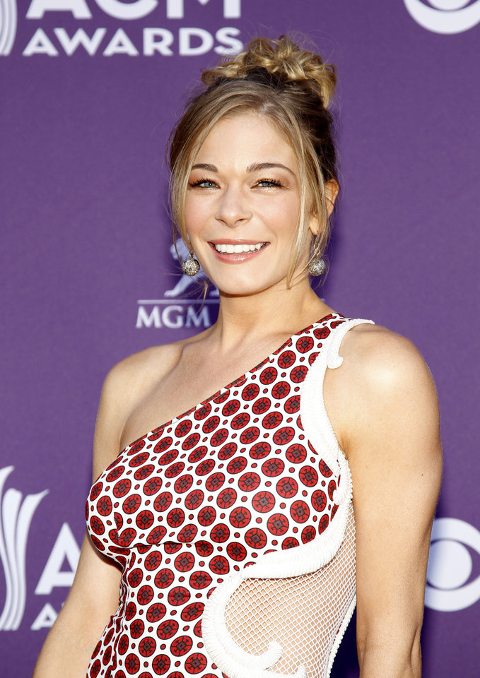 Photo -   FILE - This April 1, 2012 file photo shows country singer and actess LeAnn Rimes arriving at the 47th Annual Academy of Country Music Awards in Las Vegas. Rimes is getting professional help for anxiety and stress. Her publicist, Marcel Pariseau, says Rimes has voluntarily entered a 30-day in-patient treatment facility. He says Rimes isn't seeking treatment for an eating disorder or substance abuse. The 30-year-old Rimes checked into the facility Wednesday, Aug. 29. (AP Photo/Isaac Brekken, file)