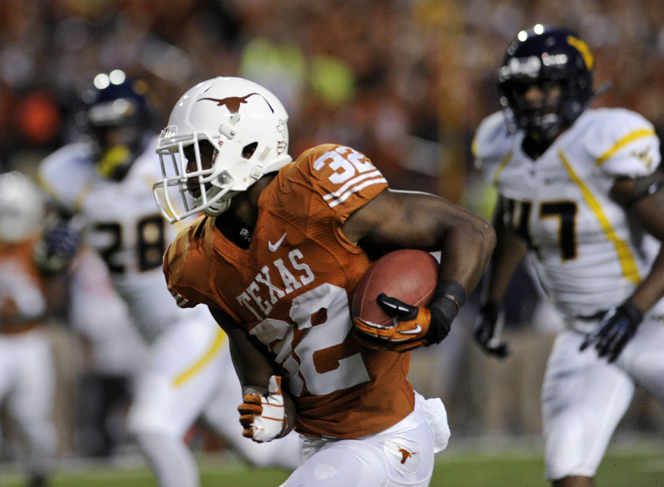 Texas running back Johnathan Gray makes his way down the field during the second quarter against West Virginia in an NCAA college football game Saturday, Oct. 6, 2012, in Austin, Texas. (AP Photo/The Daily Texan, Elisabeth Dillon)