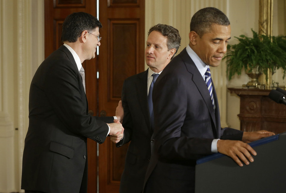 outgoing Treasury Secretary Timothy Geithner, center, shakes hands with current White House Chief of Staff Jack Lew, behind President Barack Obama in the East Room of the White House in Washington, Thursday, Jan. 10, 2013, where the president announced he would nominate Lew to succeed Geithner.   (AP Photo/Pablo Martinez Monsivais)