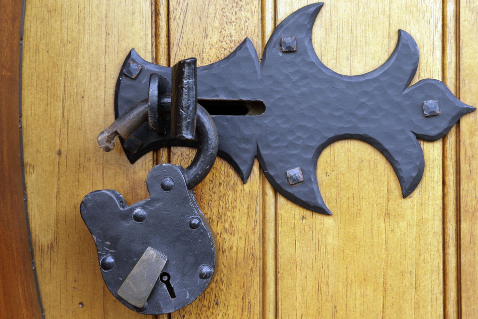 "Shown is the lock on the front door at the ""Hobbit House"" Tuesday, Dec. 11, 2012, in Chester County, near Philadelphia. Architect Peter Archer has designed a ""Hobbit House"" containing a world-class collection of J.R.R. Tolkien manuscripts and memorabilia. AP photo/"