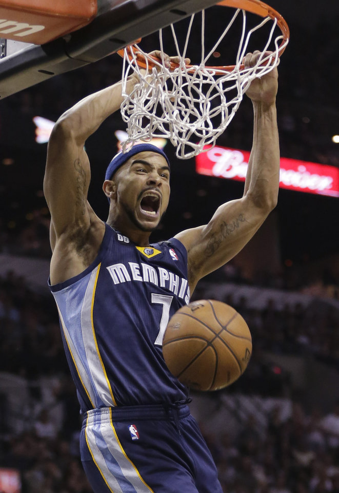 Photo - Memphis Grizzlies' Jerryd Bayless (7) reacts as he scores against the San Antonio Spurs during the second half in Game 1 of a Western Conference Finals NBA basketball playoff series, Sunday, May 19, 2013, in San Antonio. (AP Photo/Eric Gay)