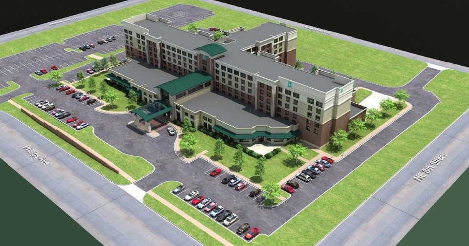 Plans for a $25 million, 194-room Embassy Suites hotel planned for NE 8 and Phillips Avenue are shown in this architect�s rendering. Photo provided