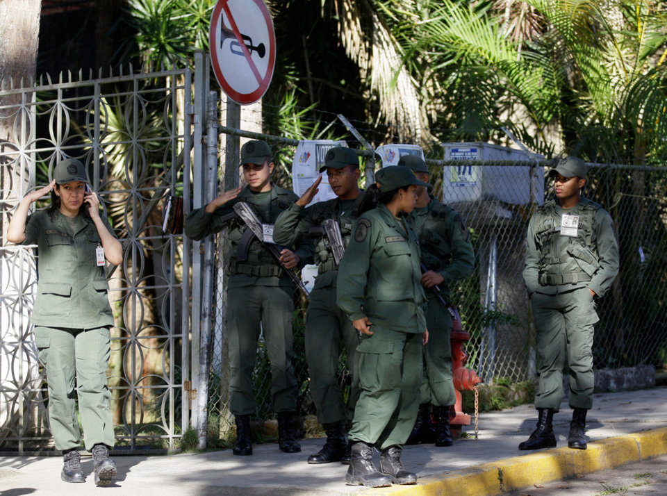 Photo - Soldiers stand on guard outside of a polling station in Caracas, Venezuela, Sunday, Dec. 16, 2012. Venezuelans are choosing governors and state lawmakers in elections that have become a key test of whether President Hugo Chavez's movement can endure if the leader leaves the political stage. (AP Photo/Fernando Llano)