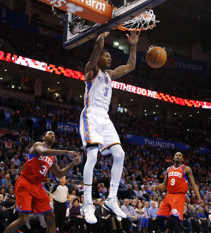 Photo - Oklahoma City's Perry Jones (3) dunks the ball as Philadelphia's Hollis Thompson (31) and James Anderson (9) watch during an NBA basketball game between the Oklahoma City Thunder and the Philadelphia 76ers at Chesapeake Energy Arena in Oklahoma City, Tuesday, March 4, 2014. Photo by Bryan Terry, The Oklahoman