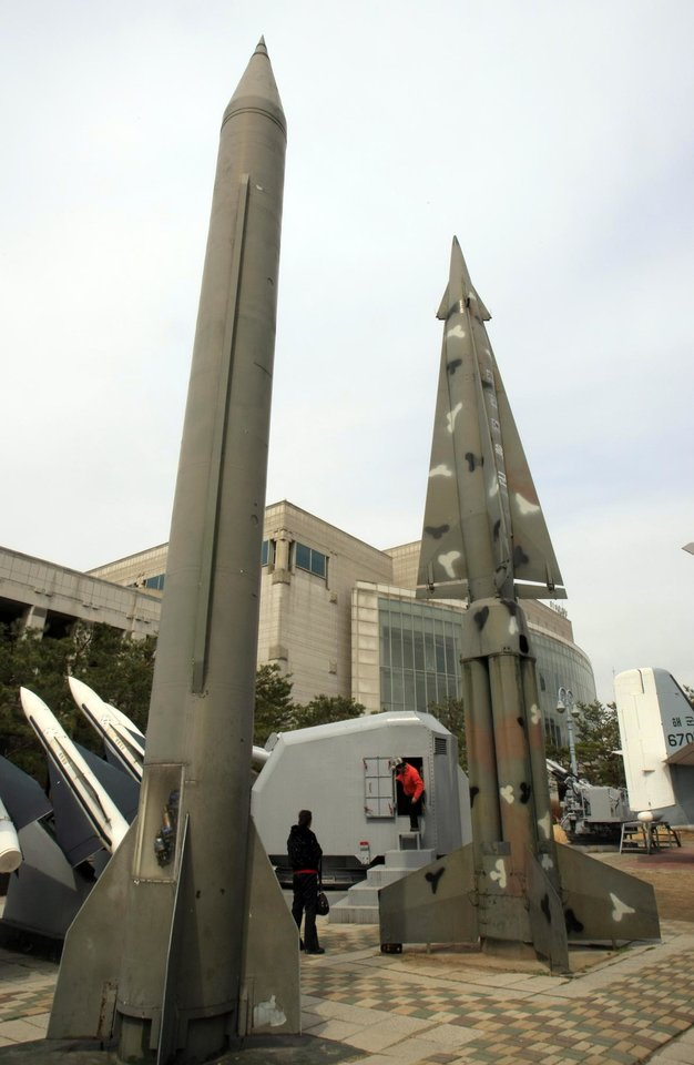 Photo -   Foreign visitors walk around mock North Korea's Scud-B missile, left, and other South Korean missiles at Korea War Memorial Museum in Seoul, Monday, March 19, 2012. North Korea vowed Sunday to go ahead with plans to launch a long-range rocket, rejecting criticism in the West that it would scuttle recent diplomacy. (AP Photo/Lee Jin-man)