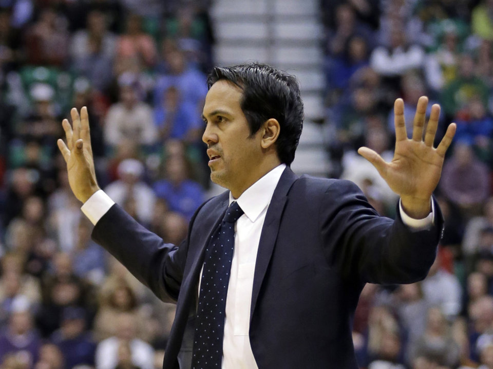 Photo - Miami Heat head coach Erik Spoelstra throws his arms up in the second half during an NBA basketball game against the Utah Jazz Monday, Jan. 14, 2013, in Salt Lake City. The Jazz defeated the Heat 104-97. (AP Photo/Rick Bowmer)
