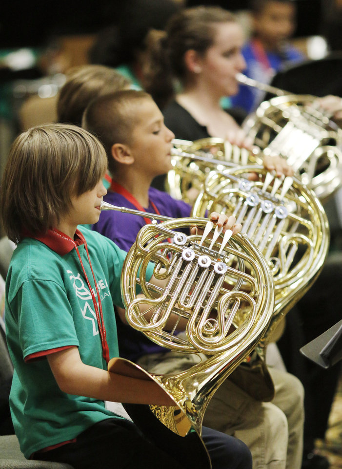 Photo - Dacey Tietz, above right, plays the bass during El Sistema Oklahoma's last concert of the school year at St. Luke's United Methodist Church, 222 NW 15.  Photos by Doug Hoke, The Oklahoman  DOUG HOKE