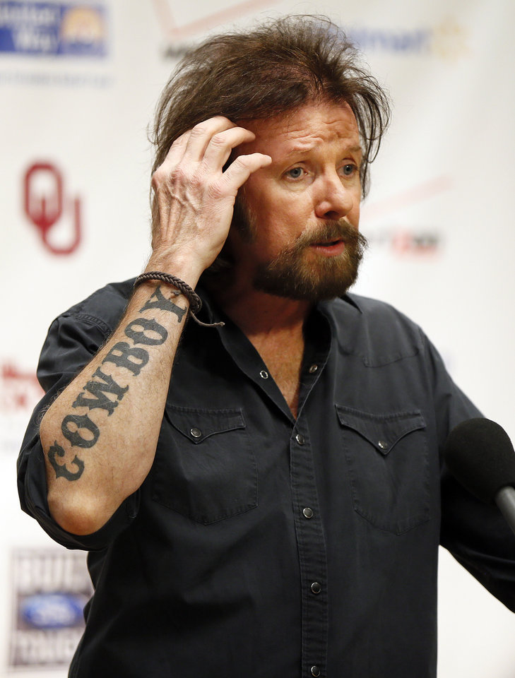 Photo - Ronnie Dunn talks with the media during the Oklahoma Twister Relief Concert, benefiting victims of the May tornadoes, at Gaylord Family - Oklahoma Memorial Stadium on the campus of the University of Oklahoma in Norman, Okla., Saturday, July 6, 2013. Photo by Nate Billings, The Oklahoman