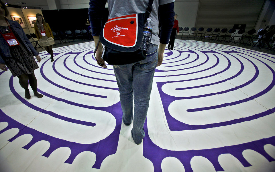 Photo - A Creativity World Forum participant begins a journey on an indoor labyrinth during the Creativity World Forum at the Cox Convention Center on Wednesday, Nov. 17, 2010, in Oklahoma City, Okla.  Photo by Chris Landsberger, The Oklahoman
