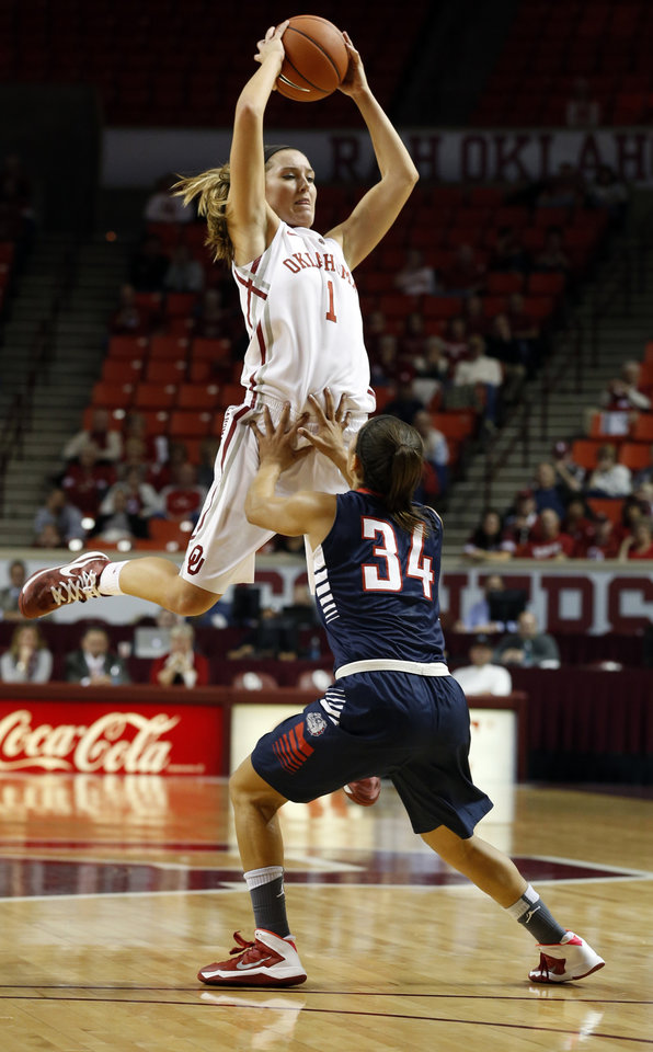 Photo - Oklahoma Sooner's Nicole Kornet (1) catches a pass over Jazmine Redmon as the University of Oklahoma Sooners (OU) play the Gonzaga Bulldogs in NCAA, women's college basketball at The Lloyd Noble Center on Thursday, Nov. 14, 2013  in Norman, Okla. Photo by Steve Sisney, The Oklahoman