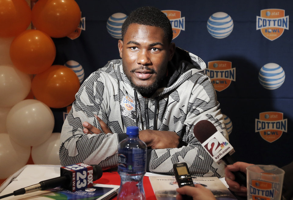 Photo - Oklahoma State junior running back Desmond Roland speaks to the media during an NCAA college football press conference, Wednesday, Jan. 1, 2014, in Irving, Texas. Oklahoma State takes on Missouri in the Cotton Bowl on Friday in Arlington, Texas. (AP Photo/Brandon Wade)