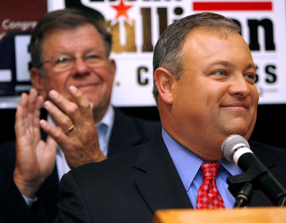 Photo - With State Senator Mike Johnson applauding in the background, State Senator Glenn Coffee smiles as he announces a victory for Oklahoma Republicans during the Republican watch party at the Oklahoma City Marriott on Northwest Expressway in oklahoma City on Tuesday Nov. 4, 2008. By John Clanton, The Oklahoman