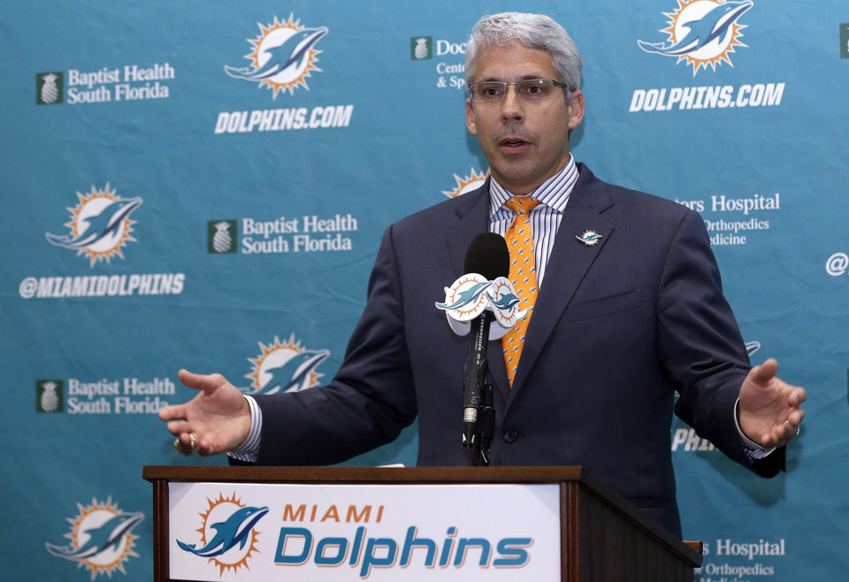 Photo - Dennis Hickey, new general manager for the Miami Dolphins NFL football team, speaks after being introduced during a news conference, Tuesday, Jan. 28, 2014, in Davie, Fla. (AP Photo/Lynne Sladky)