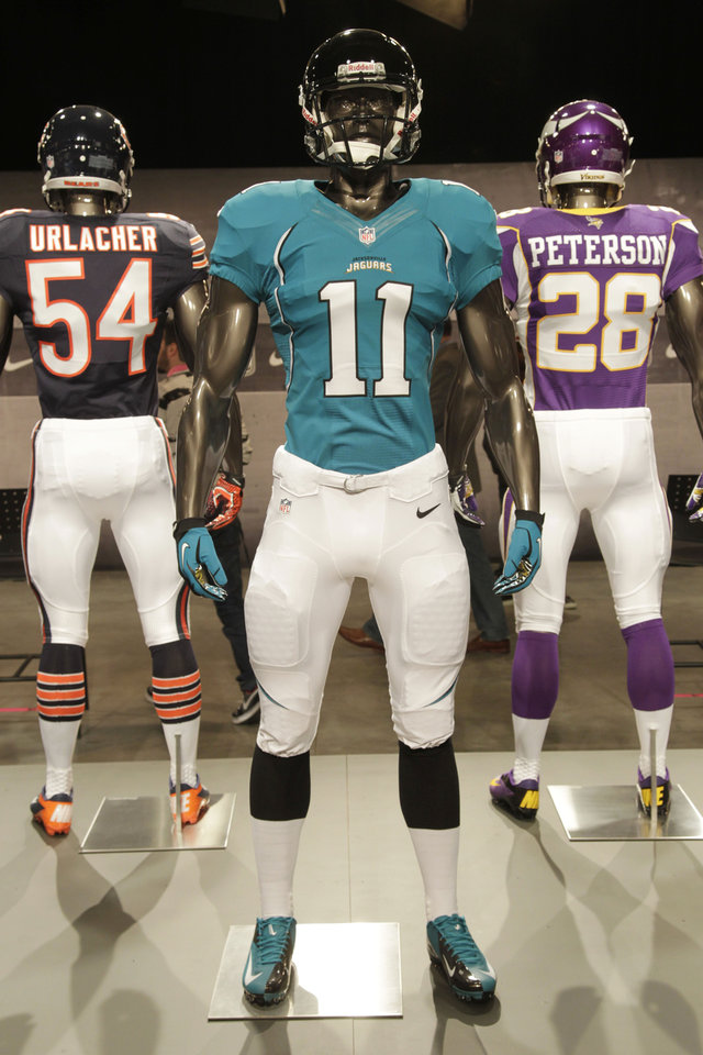 The new Jacksonville Jaguars uniform is displayed on a mannequin in New York, Tuesday, April 3, 2012. NFL has unveiled its new sleek uniforms designed by Nike. While most of the new uniforms are not very different visually, they all are made with new technology that make them lighter, dryer and more comfortable. (AP Photo/Seth Wenig)